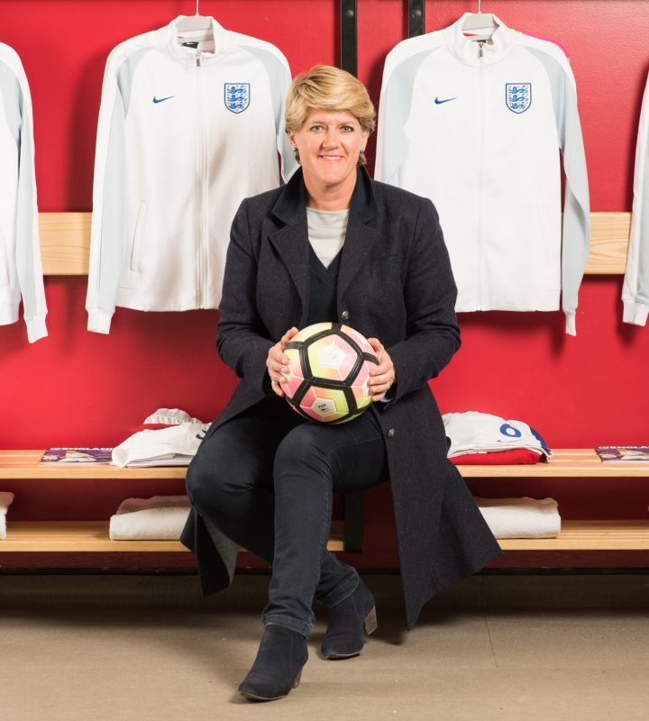 Clare Balding and England Women's Football team, Milton Keynes stadium.  England v Austria Women's International.  Clare Balding in the England Women's changing room before the game.  April 10, 2017.  Photo: Eleanor Bentall  Tel: +44 7768 377413
